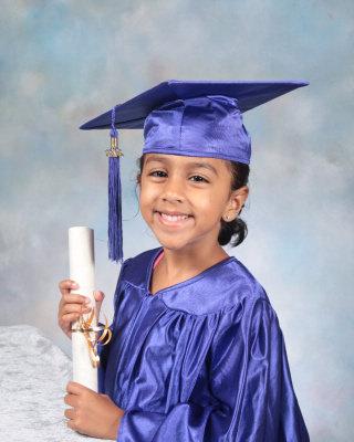 girl holding her diploma